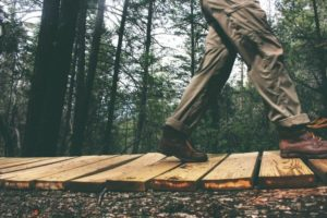 Man on boardwalk in bushcraft pants