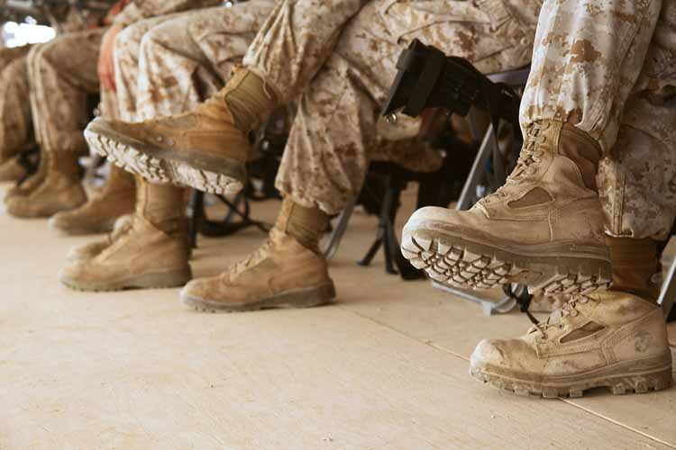 Soldiers sitting with their combat boots on