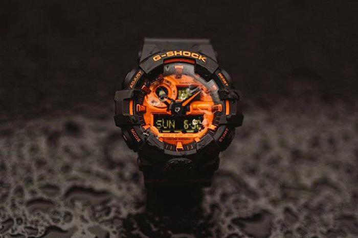 Black and orange Casio G shock watches